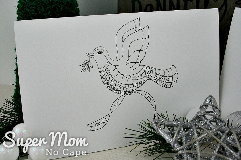 Close up photo of uncolored Christmas Dove card
