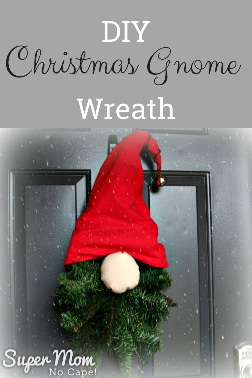 Gnome Wreath made with a teardrop door swag, a red hat and a stuffed nose.