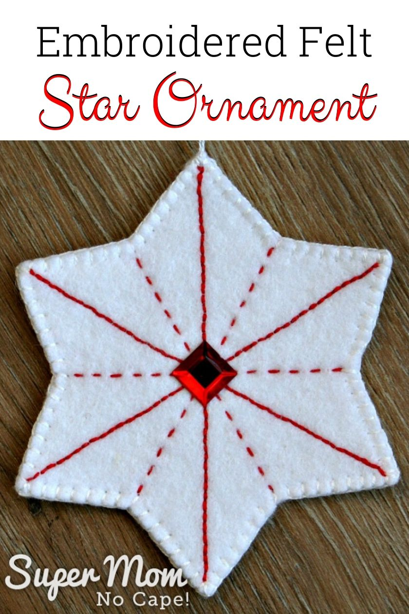 Embroidered Felt Star Ornament text over top of a white felt star with red embroidery and a red gem in the center.