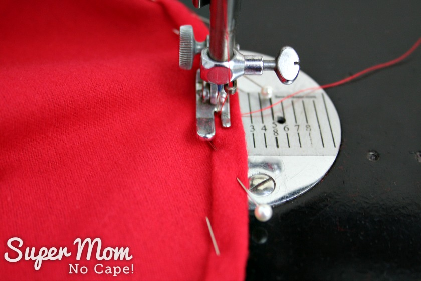 Machine hemming the bottom of the red gnome hat.