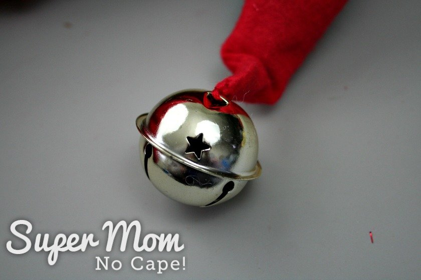 A silver bell sewn to the tip of the red gnome hat.