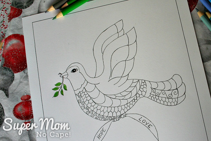 The Christmas Dove coloring page with the branch and leaves colored green.