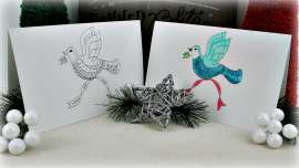 Two Christmas Dove coloring cards - one uncolored and one colored.