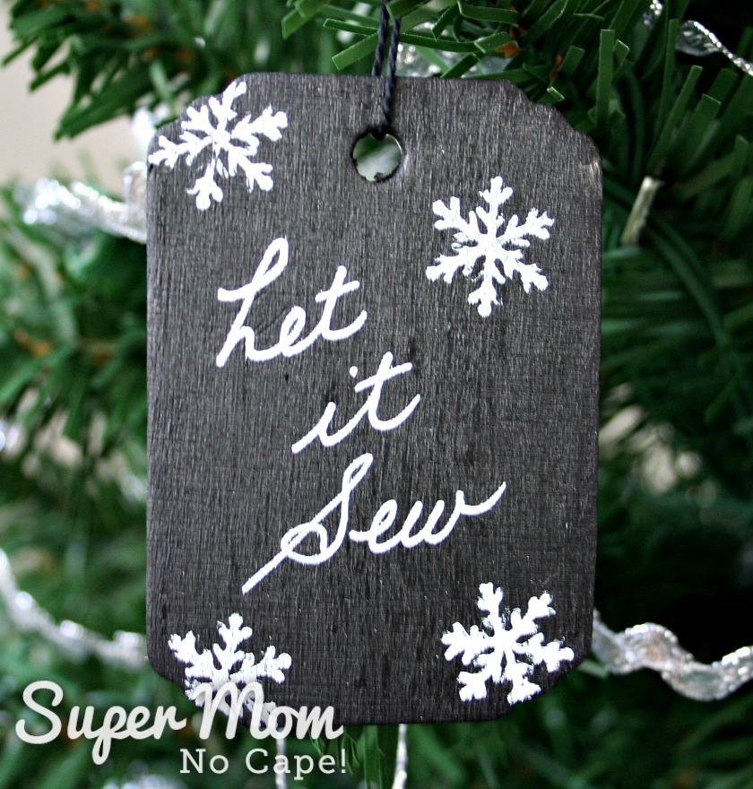 Let it Sew tag hanging on tree