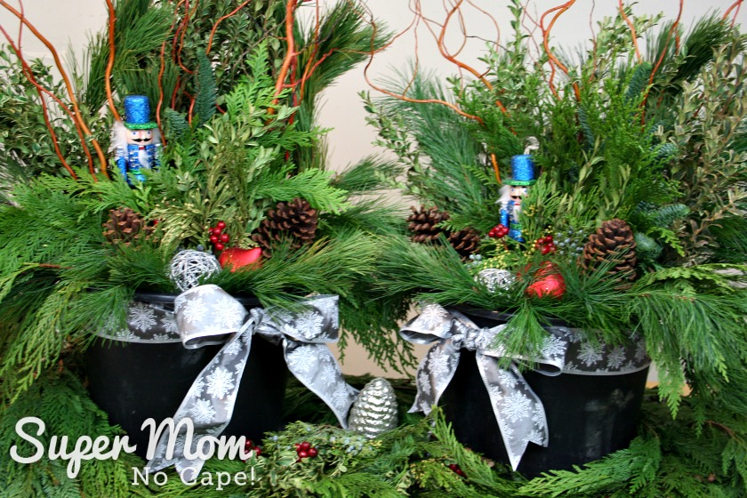 Two outdoor Christmas planters made for the video tutorials for the Handmade Homemade Holidays members.