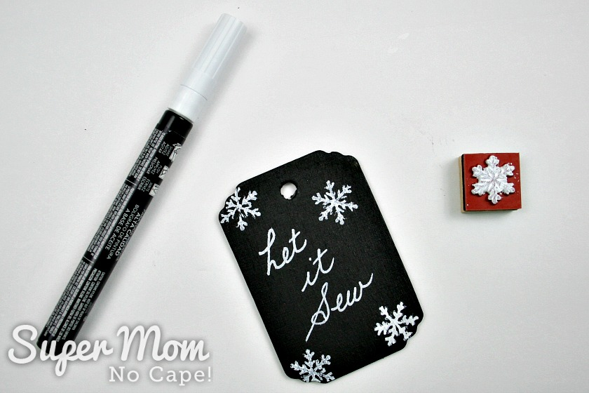 Paint pen, Let it Sew tag and snowflake stamp