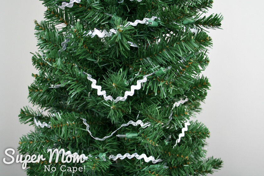 Silver rick rack strung as garland on the sewing themed Christmas tree.