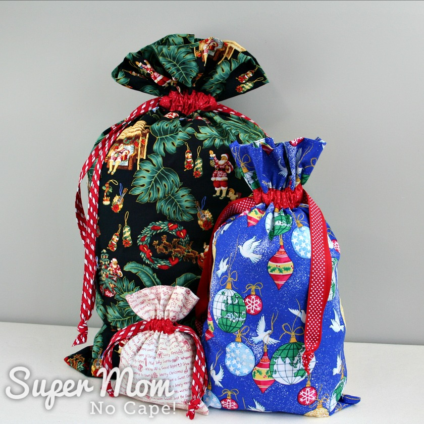Three drawstring gifts bags in three different sizes and three different fabrics.