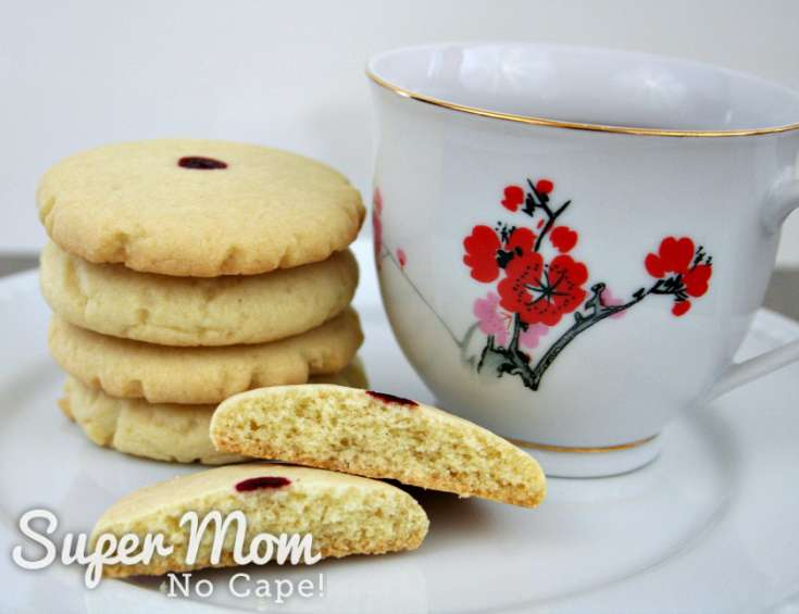 Red dot almond cookies served with a cup of tea