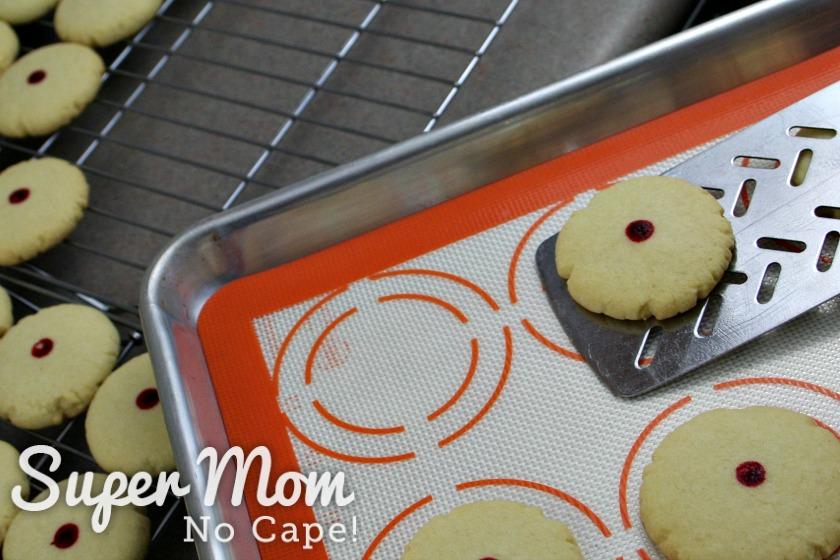 Transferring almond cookies to baking racks