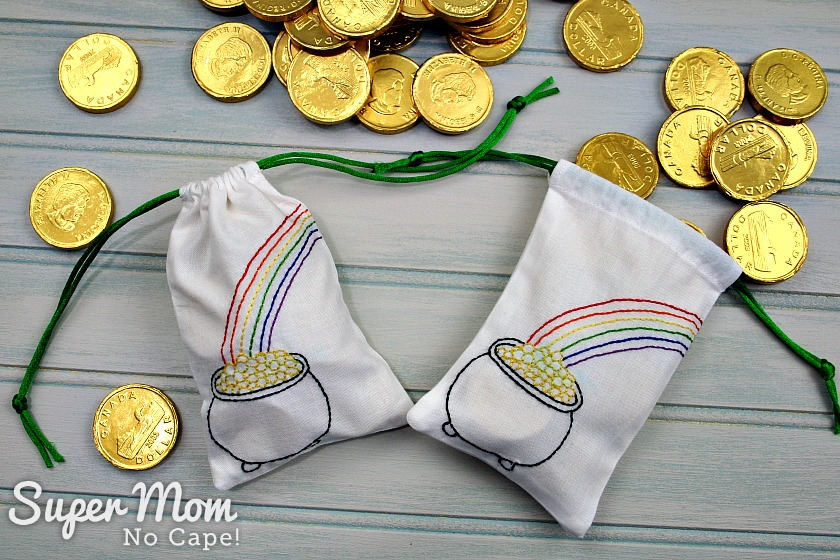 Drawstring bags with embroidery and pile of gold coins