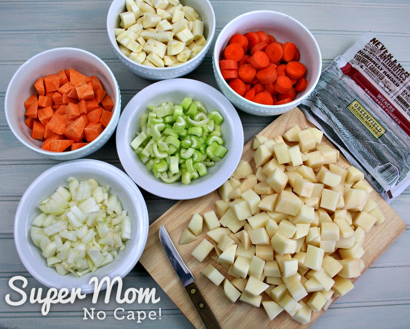 Bowls of cut up veggies and packages of wieners to make wiener stew