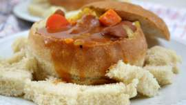Wiener stew in a bread bowl
