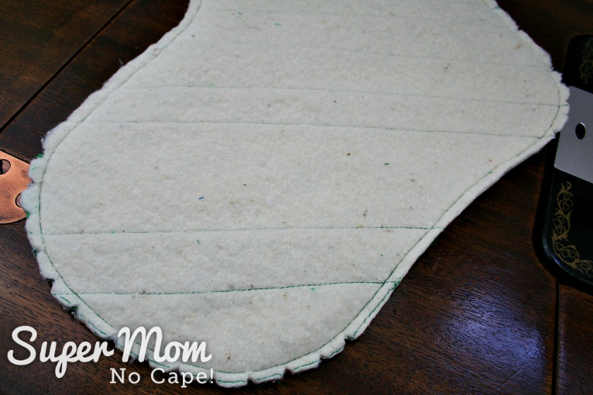 The quilted stocking sewn together with the seam allowance trimmed and curves notched.