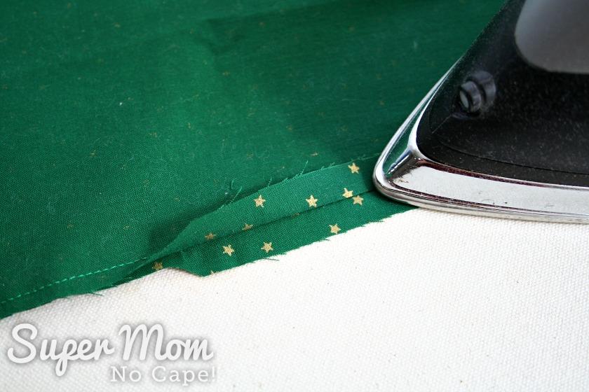 An iron pressing the seam allowance open