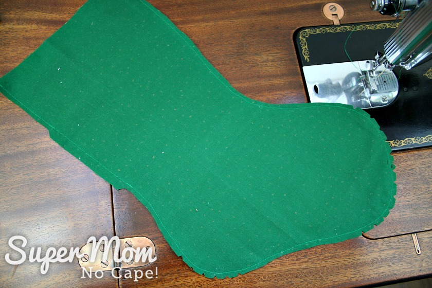 Green lining for the stocking after the seam allowance has been trimmed with curves notched