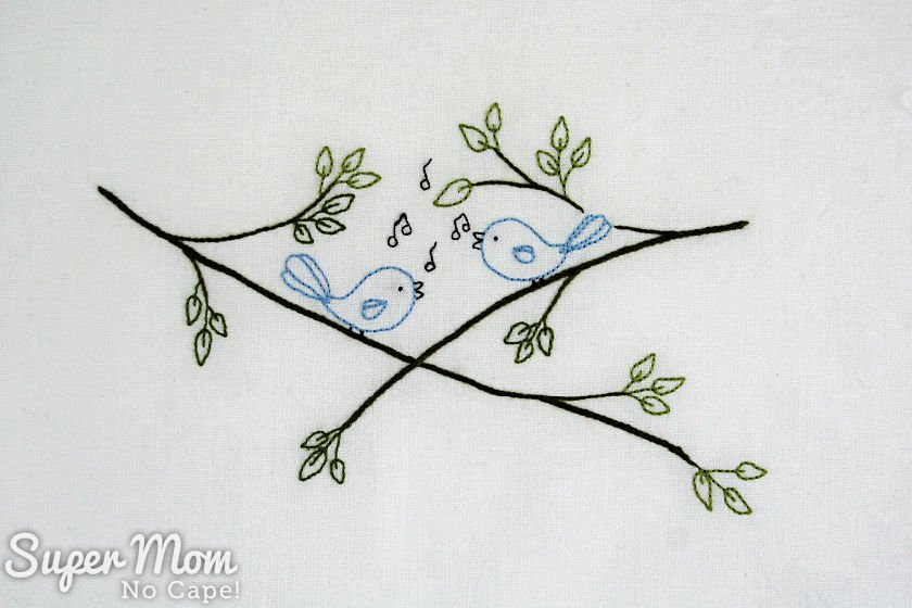 Finished Songbirds embroidery before framing.