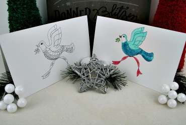 Photo of two Christmas Dove cards, one colored, one uncolored
